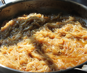 Slow cooked caramelized onions.   A City Farm staple.  By City Farm Events Boston.