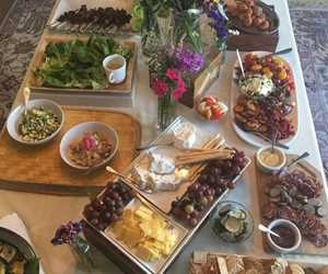 A colorful table of appetizers and antipasto including duck tacos, local cheese & fresh veggies. By City Farm Events Boston.