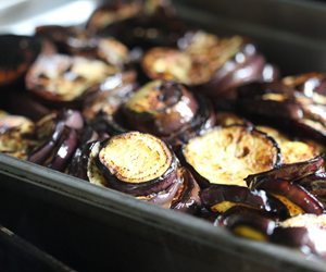 Perfect Grilled Eggplant stacked in a hotel pan.  By City Farm Events Boston.